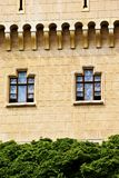 Castle wall with windows. Part of castle wall with two windows stock photos