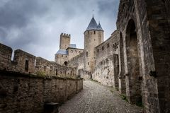 Castle walls of Carcassonne fortress in France with crowd clouds on the background Stock Photos