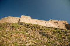 Castle walls on the rocks Royalty Free Stock Photo