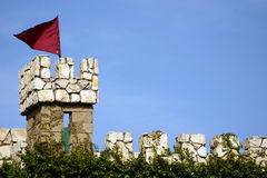 Castle Watch Tower. Castle wall with red flag. Plenty of space for text stock image