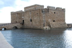 Castle in water. Medieval castle surrounded by water and overlooking the town port in Paphos, Cyprus Stock Photo