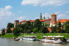 Castle Wawel in Krakow (Poland). Ships on the river Royalty Free Stock Photo