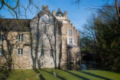 Castle Werdringen. Nearby Hagen, Germany, Westphalia with turrets and Moat during spring, huge trees Royalty Free Stock Images