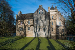 Castle Werdringen. Nearby Hagen, Germany, Westphalia with turrets and Moat during spring, huge trees, romanic, gothic mixed style architecture, historic Royalty Free Stock Images