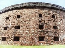 Castle Williams exterior. Castle Williams is a circular fortification of red sandstone on the northwest point of Governors Island in New York harbor United royalty free stock photography