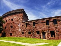 Castle Williams exterior. Castle Williams is a circular fortification of red sandstone on the northwest point of Governors Island in New York harbor United royalty free stock photos