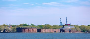Castle Williams on Governors Island view from New York Harbor. New York, USA - May 9, 2018 : Castle Williams on Governors Island view from New York Harbor Royalty Free Stock Photos
