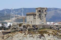 Castle and wind turbines in tarifa, Cádiz Stock Photography