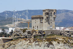 Castle and wind turbines in tarifa, Cádiz Stock Photography