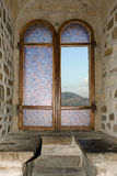 Castle window. View on mountain through stained glass window Stock Image