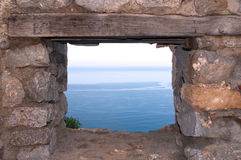 A castle window. View through the castle window to the sea stock images