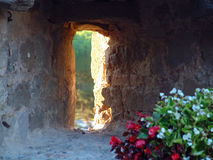 Castle Window. Sunlight outlines a window slit in the castle in Montalcino, Italy royalty free stock photography