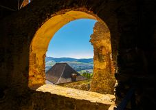 Castle window view in to the beautiful mountainous. Lovely summer weekend in Stara Lubovna, Slovakia Royalty Free Stock Photography