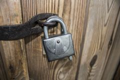 Castle on wooden gate. Old lock on a wooden door of the gate, Ukraine, Lviv Royalty Free Stock Images
