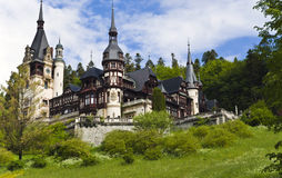 Castle in the woods. View of The Peles Castle, summer residence of Romanian kings. The Peles Castle is one of the most important historic edifices in Romania Stock Photo