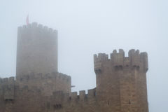 Castle of Xavier on a foggy day (Spain) Royalty Free Stock Photo