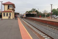 A public transport V/Line passenger train at the Castlemaine railway station platform. CASTLEMAINE, AUSTRALIA - June 9, 2019: A public transport V/Line passenger royalty free stock image