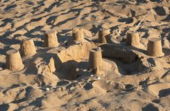 Castleof sand over the beach stock photos