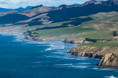 Castlepoint Coastline. Showing farmland right up to the coastal cliffs Stock Images