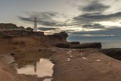 Castlepoint Lighthouse on Rock Stock Image
