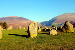 Castlerigg Stone Circle, Cumbria. Keswick, Cumbria, UK. January 26, 2017. The ancient Castlerigg stone circle with the mountains of Lonscale fell and Blencathra Royalty Free Stock Photo