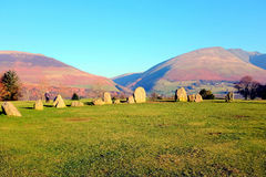 Castlerigg Stone Circle. Keswick, Cumbria, UK. January  26, 2017.  The Castlerigg stone circle with the mountains of Lonscale fell and Blencathra behind at Royalty Free Stock Image