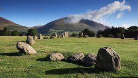 Castlerigg Stone Circle. Is situated near Keswick, Cumbria in the English Lake District national park. Blencathra one of the highest peaks in Cumbria is in the stock footage