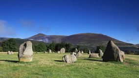 Castlerigg Stone Circle. Is situated near Keswick, Cumbria in the English Lake District national park. Blencathra one of the highest peaks in Cumbria is in the stock video footage