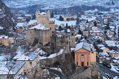 Castles of the Aoste Valley in Italy in Winter. The Aoste Valley in Italy is full of ancient castles and ruins. Panoramic view of this castle in winter with snow stock photo