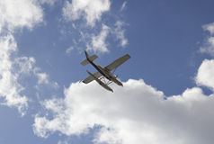 The plane on a background of blue sky Stock Photos
