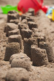 Castles on the sand. A series of small castles on a sandy beach Stock Photography