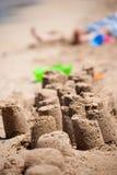 Castles on the sand. A series of small castles on a sandy beach Stock Photos