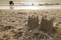 Castles in the Sand. Sand castles on a beach at twilight time stock image
