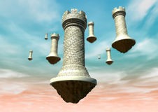Castles In The Sky. A concept image showing brick made chess castles that are floating against a pnk and blue sky