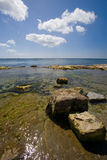 Castletown Isle of Man shoreline. With rocks in foreground Royalty Free Stock Photography