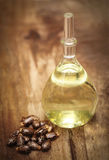Castor beans and oil. In a glass jar stock images