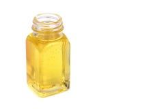 Castor oil in glass bottle on white background royalty free stock photos