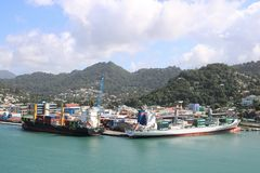 Castries, Saint Lucia. Panoramic view of Castries, the capital of Saint Lucia, with two ships in the cargo port and the city centre on the left. In the Royalty Free Stock Photos