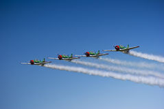 Castrol Flying Lions Harvard Aerobatic Team. The Castrol Flying Lions Harvard aerobatic team, treat spectators to a marvelous display of formation flying Stock Photography