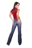 Casual. Girl in jeans posing in studio Royalty Free Stock Images