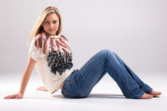 Casual. Dressed in blue jeans a shirt stripes and stars, american style stock image