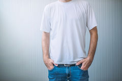Casual adult male wearing blank white t-shirt Stock Images