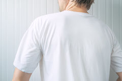 Casual adult male wearing blank white t-shirt from behind Stock Photos