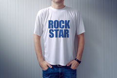Casual adult male wearing t-shirt with Rock Star title Royalty Free Stock Photography