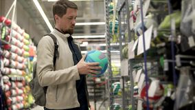 Sportsman buy new ball. stock footage