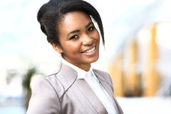 Casual african business woman. Looking happy and smiling Royalty Free Stock Photos