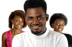 Casual African man with female friends. Casual African men with female friends smiling against white background royalty free stock images