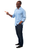 Casual african man pointing away Royalty Free Stock Image
