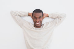 Casual Afro young man against a wall Stock Image