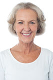 Casual aged woman posing for camera stock photo